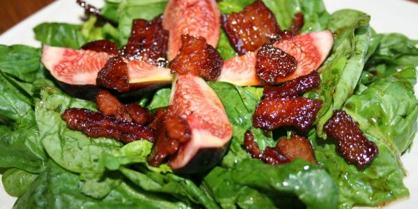 Spinach salad with warmed bacon dressing