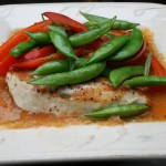 Chicken breast with roasted garlic tomato sauce, peppers and peas