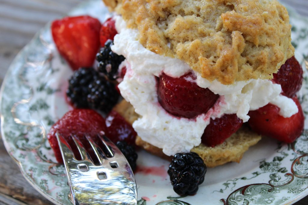 Sweet gluten free buttery biscuits with fresh berry medley and whipped cream